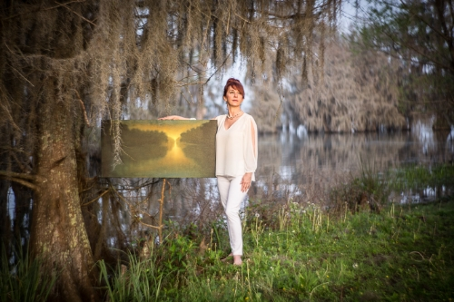Artist Melissa Bonin with one of her paintings at Lake Martin, Louisiana in 2015. Through many days of research and conversations we knew we had to be at the lake one hour before sunrise to be setup and ready for the magic of the morning