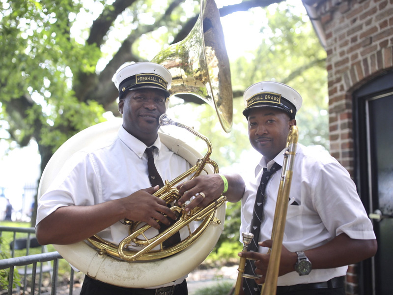 The Preservation Hall Brass Band relax in the shade before their opening set at Satchmo 2016