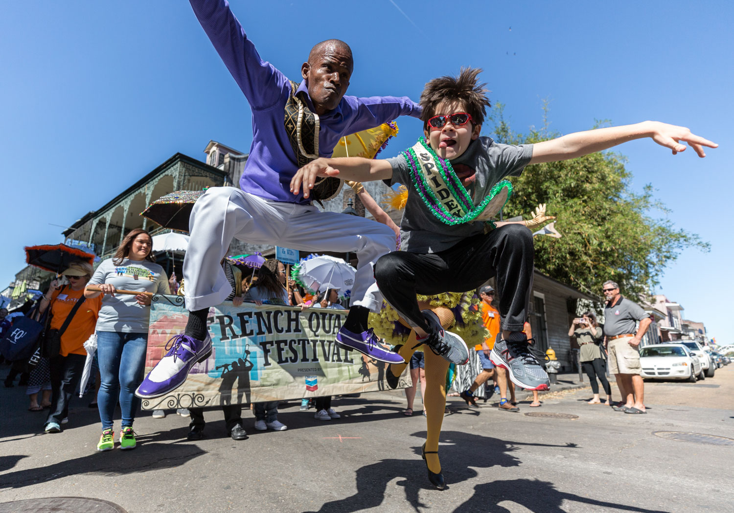 Dancing Man 504 and Spidey 504 lead the 2nd Line Parade on opening day of French Quarter Fest 2017