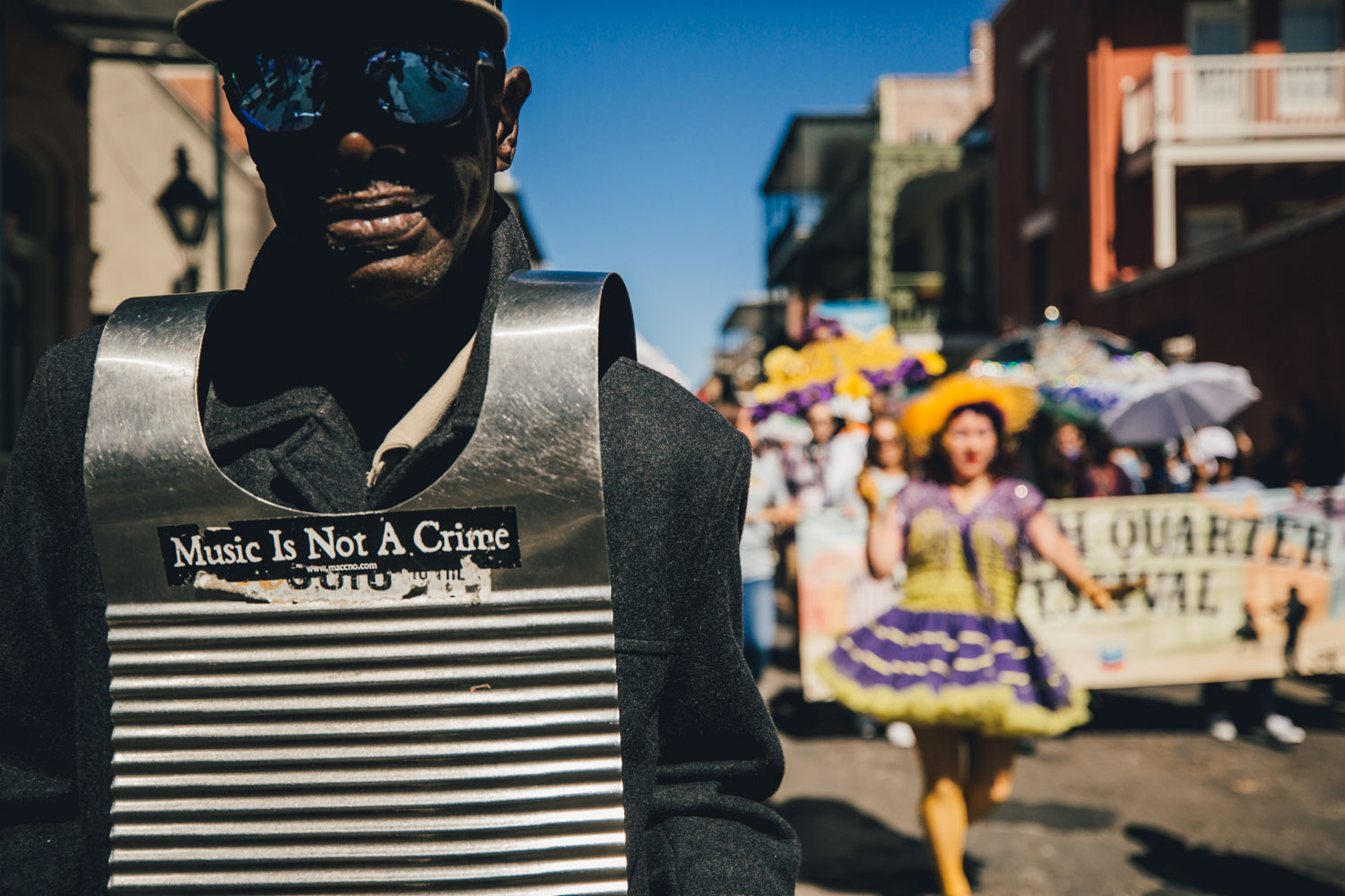 A musician stands before the opening day parade for French Quarter Fest on St. Ann St. in the French Quarter.