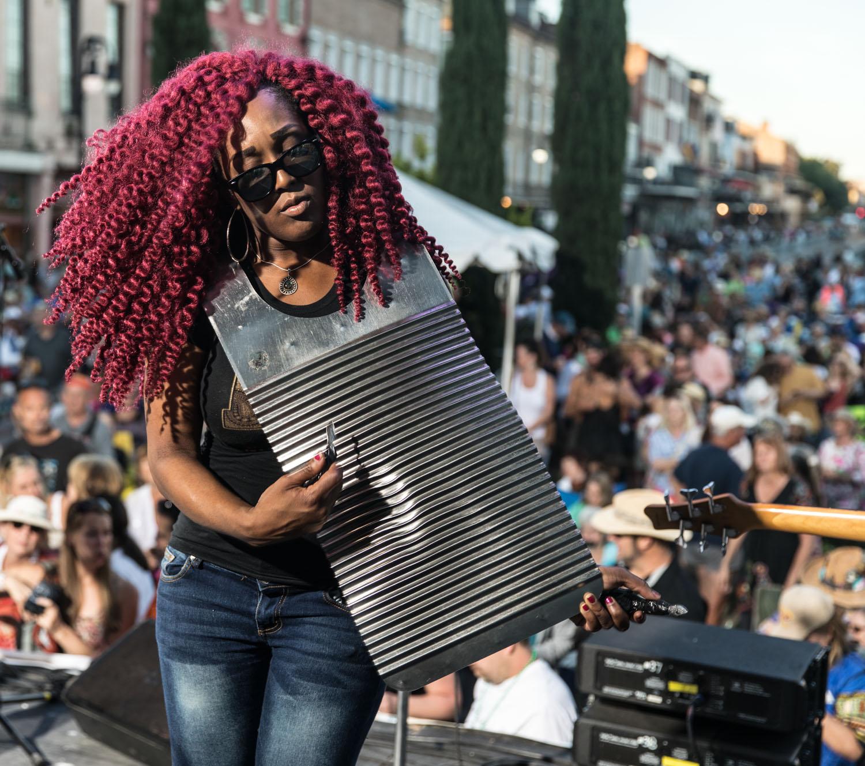 LaTasha Covington on washboard amidst a sea of fans at the Cajun/Zydeco Stage.