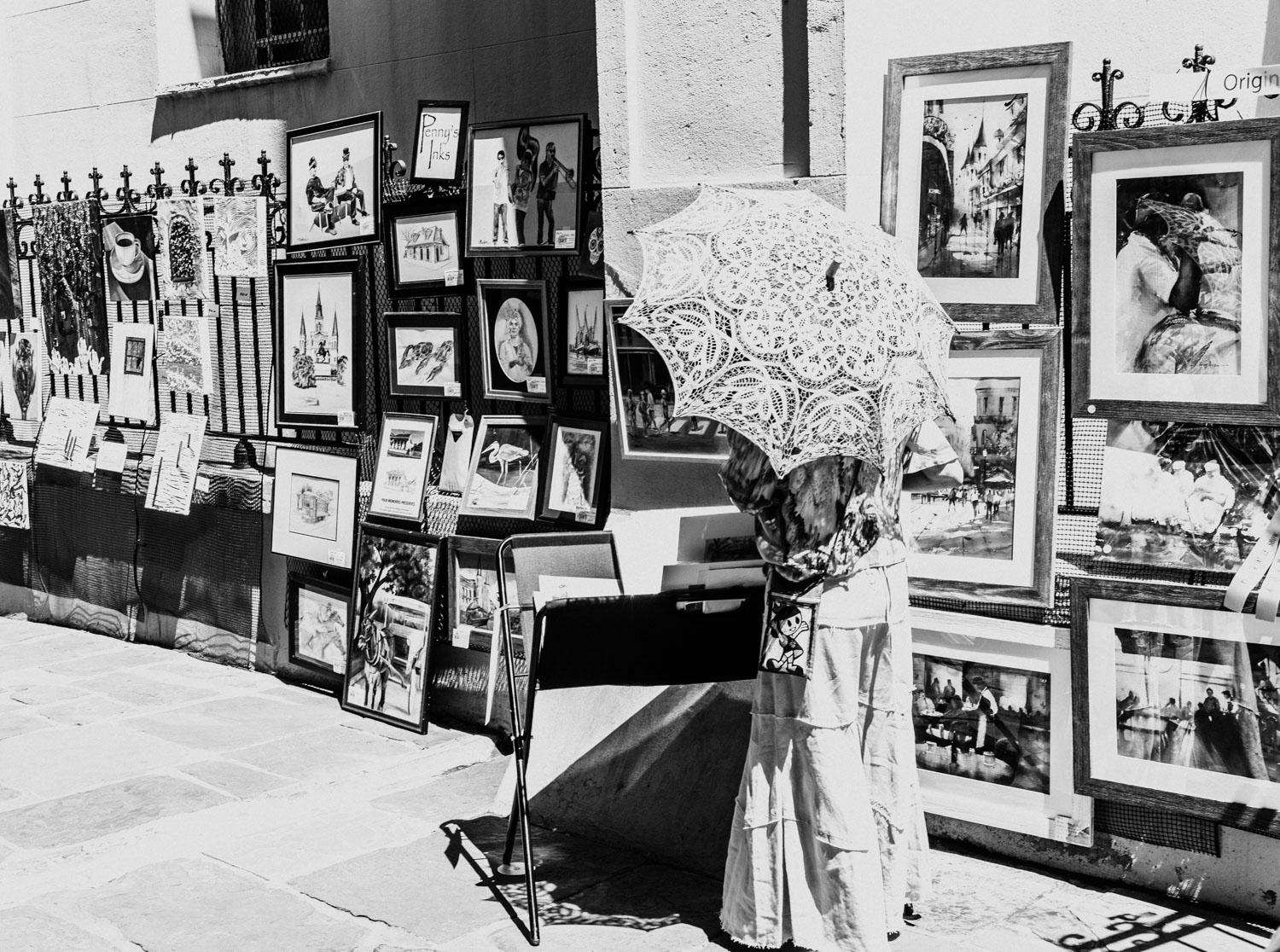 I was captivated by this woman and her umbrella as she perused paintings during the Pirate