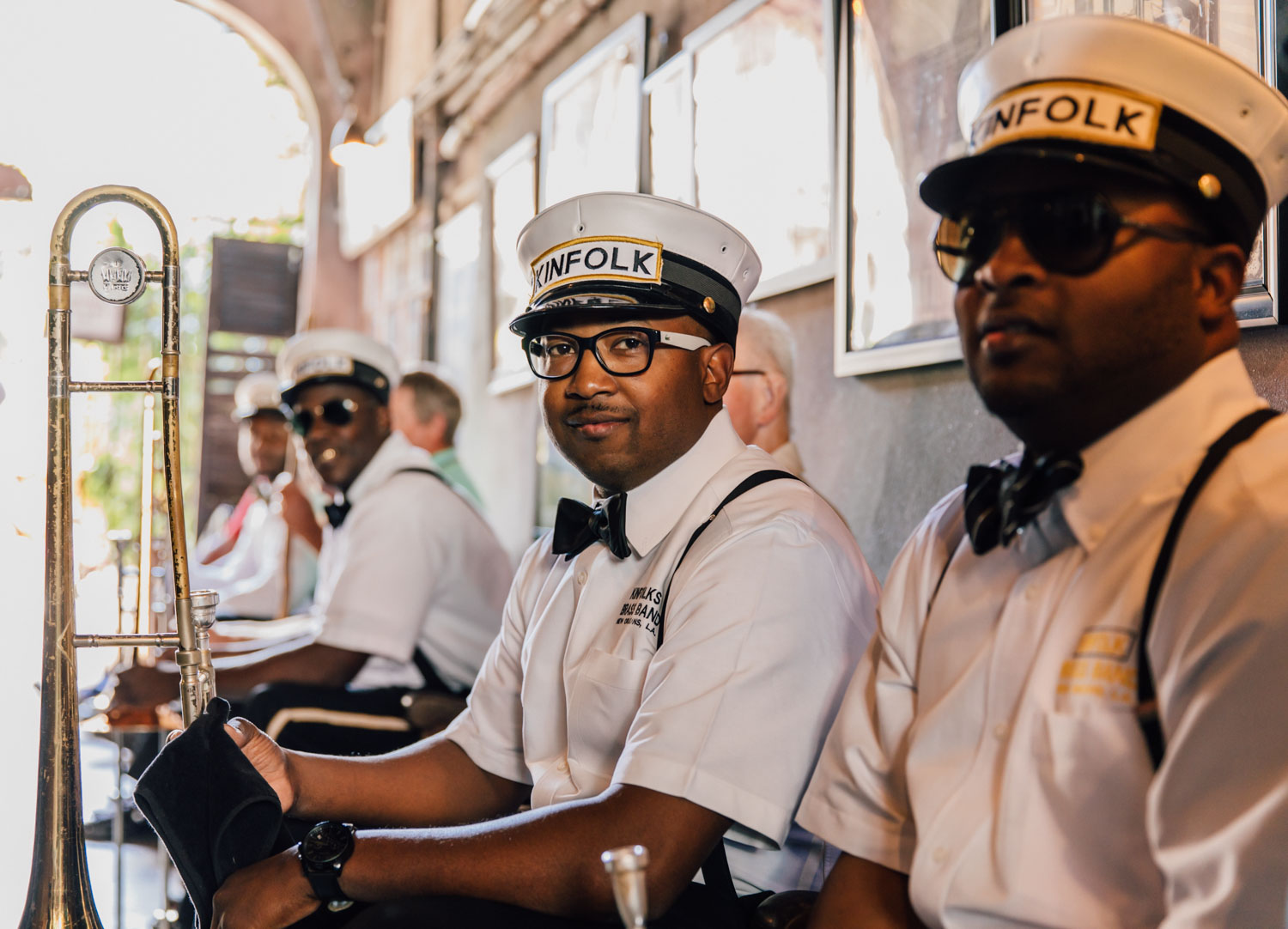 Richard Anderson of the Kinfolk Brass Band and band mates await their call to the stage at the historic Preservation Hall.