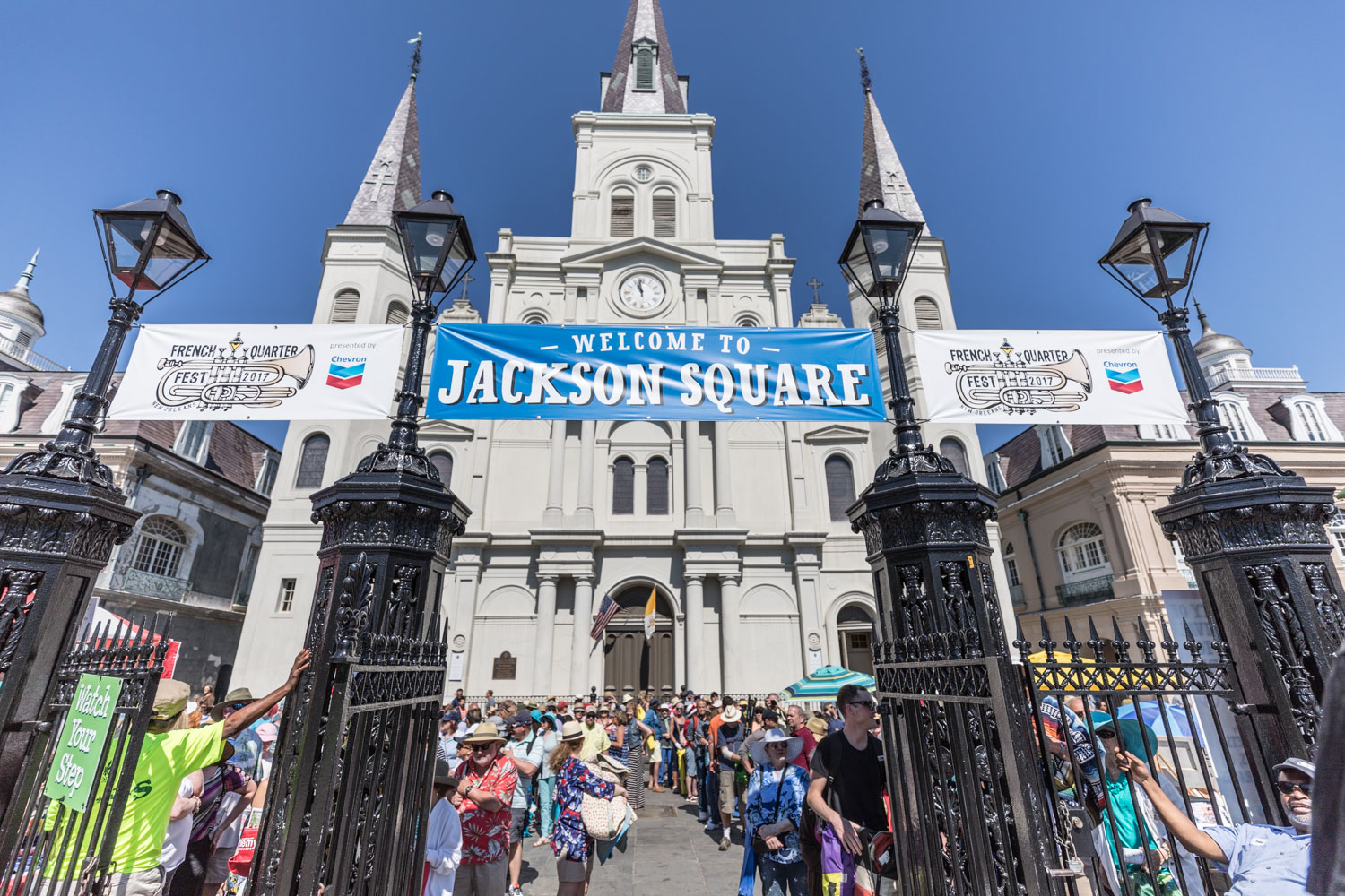 Crowds await the chimes of St. Louis Cathedral to ring them in Saturday