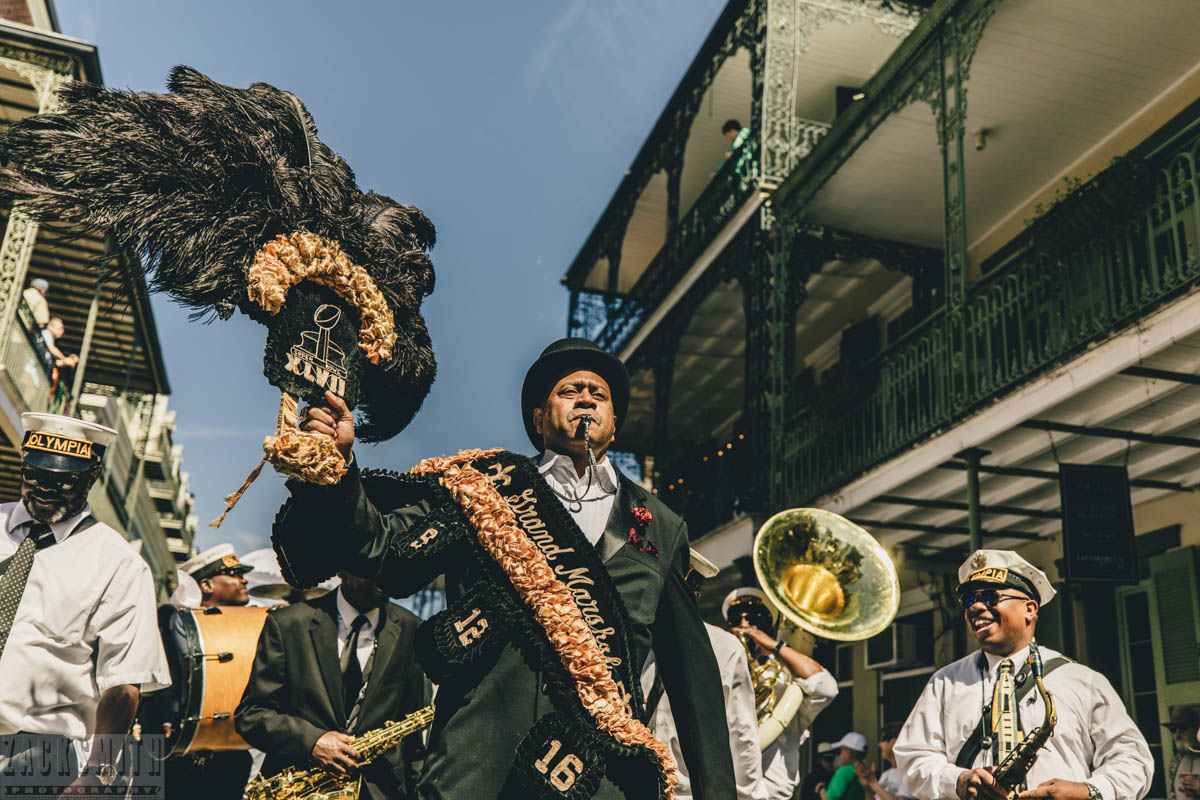 Olympia Brass Band leads the opening parade to begin French Quarter Fest 2018. ©ZSP